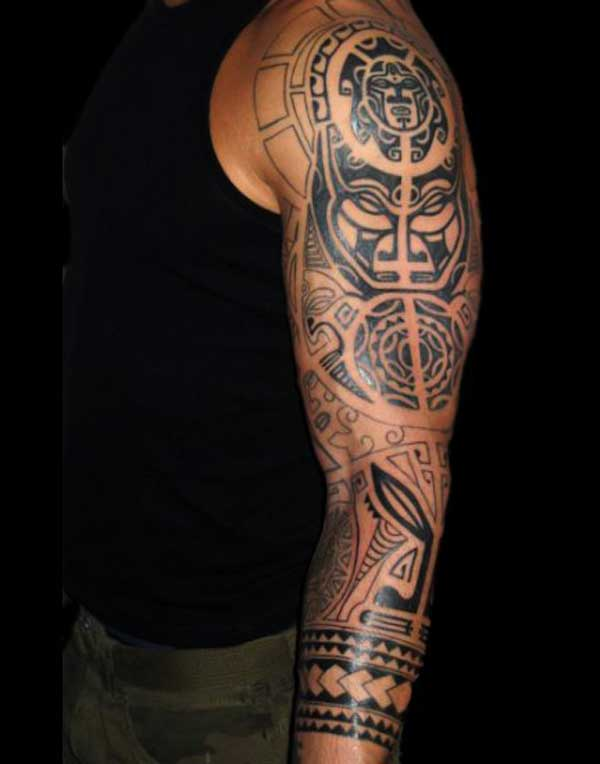 b8ed36213 Black Ink Maori Tattoo On Man Left Sleeve