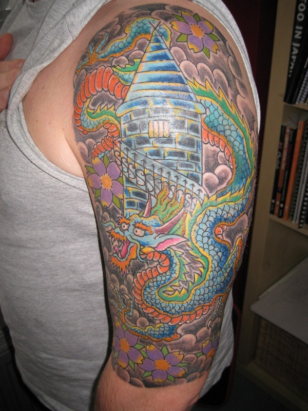 Colored dragon tattoo on left arm for men for Dragon arm tattoos for men