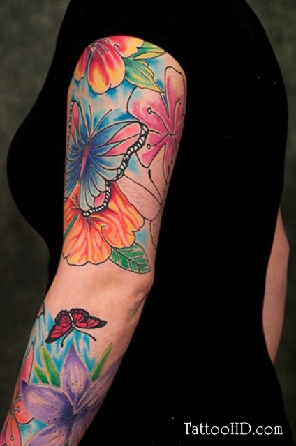 Colored flowers and butterfly tattoo on arm for Flower tattoos on arm
