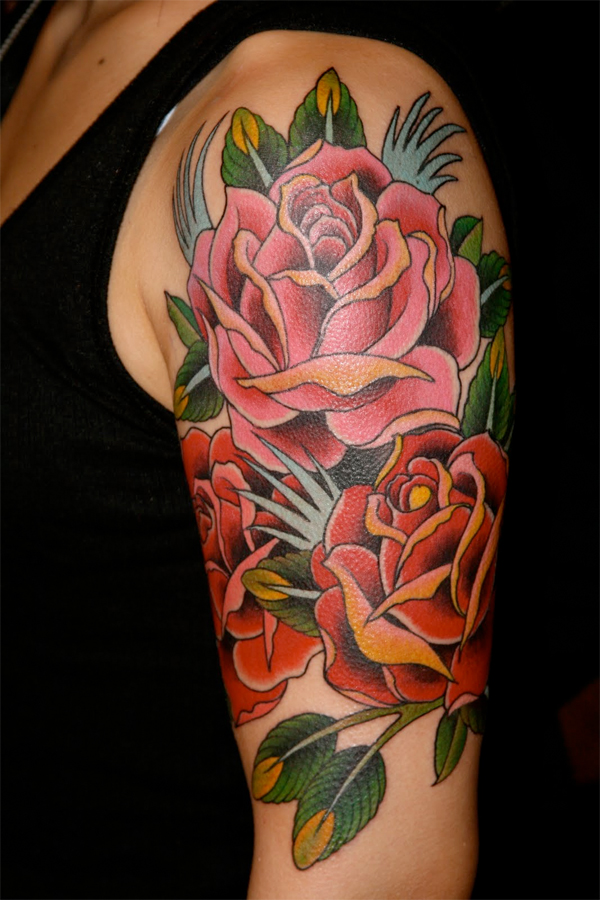 Colored Rose Flowers Tattoo On Arm