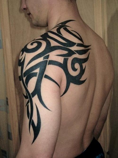 Man left arm tribal tattoo for Tribal bicep tattoos