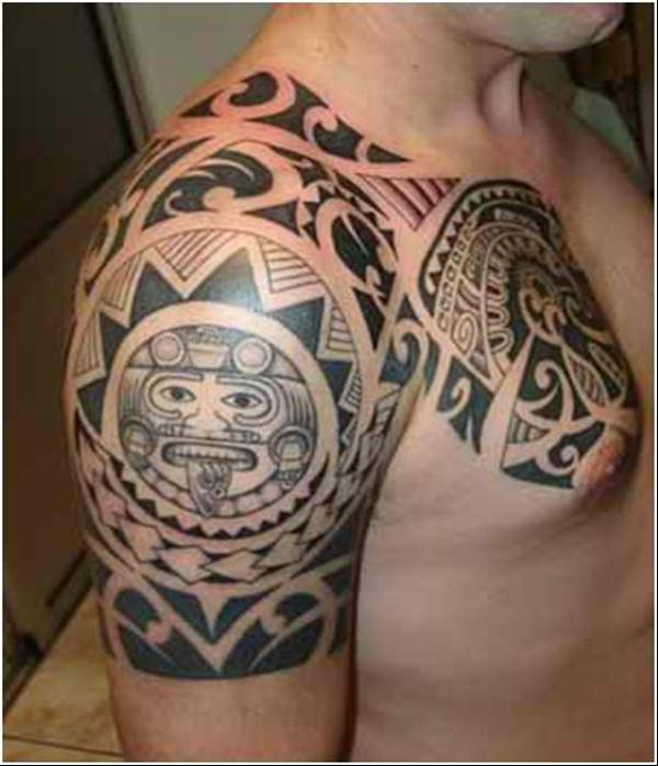Maori tattoo on man chest and right arm for Tattoos on right arm