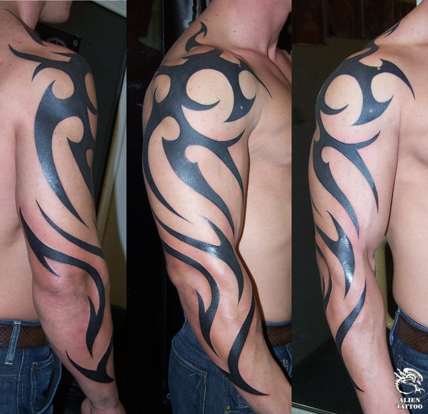 Arm tattoo images designs for Black tribal tattoo ink