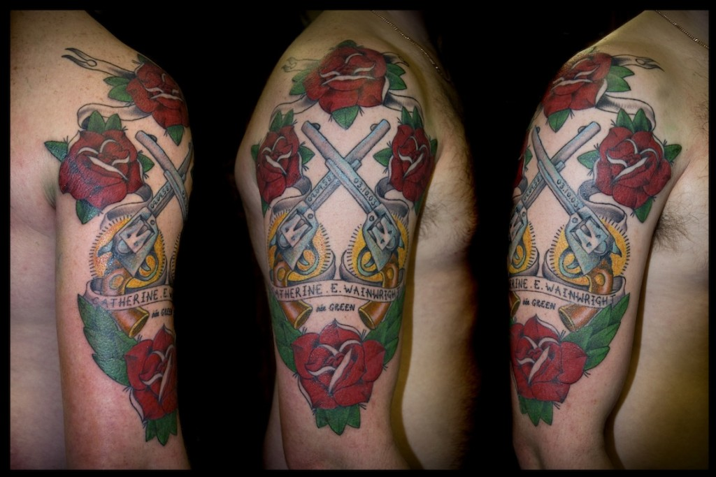 Red rose flowers and guns tattoos on right arm for Right arm tattoos
