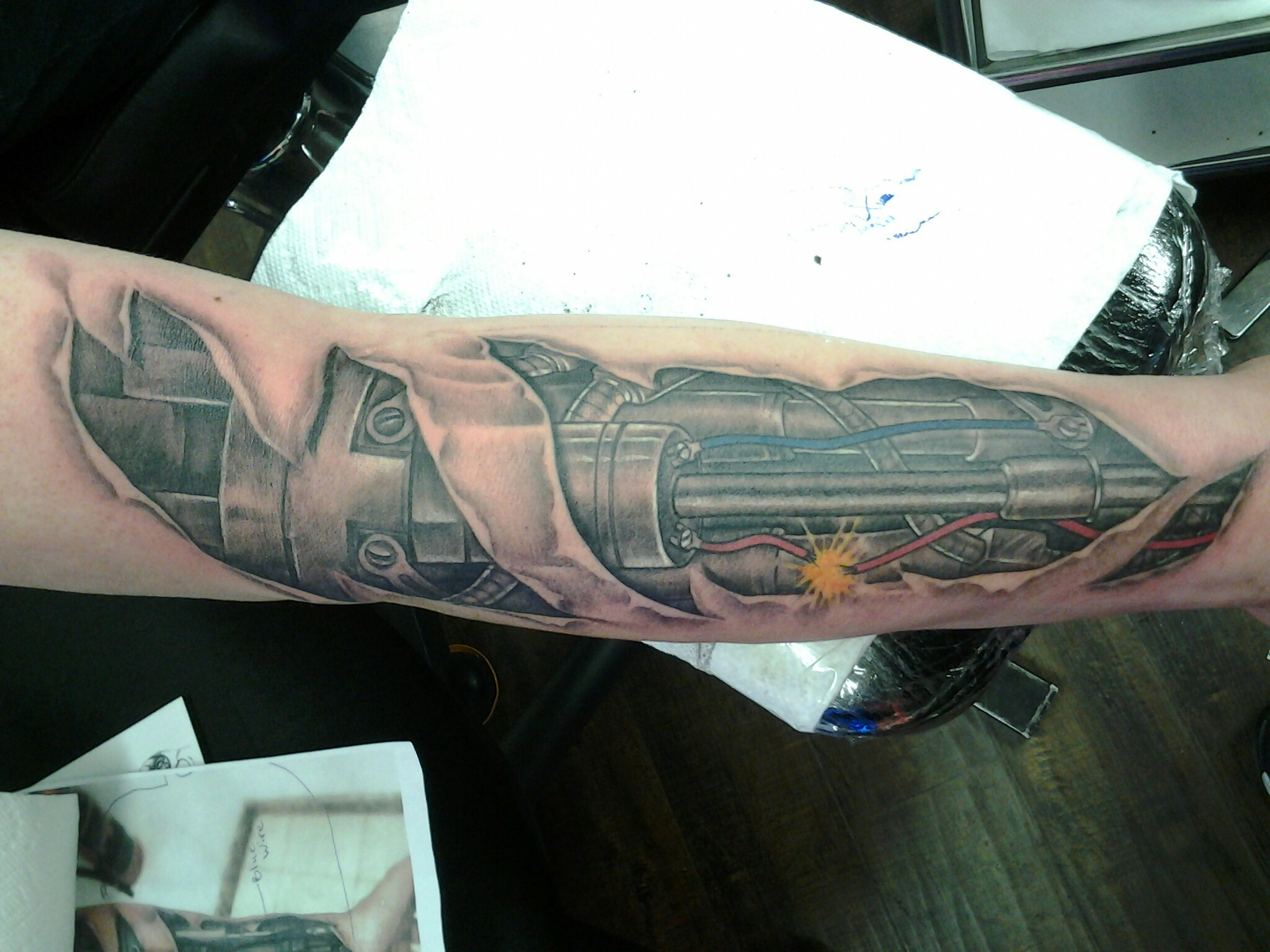Biomechanical Ripped Skin Tattoo On Sleeve