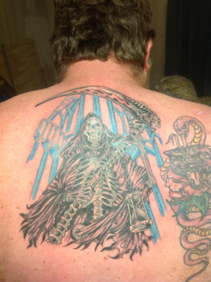 Color Ink Grim Reaper Tattoo On Back