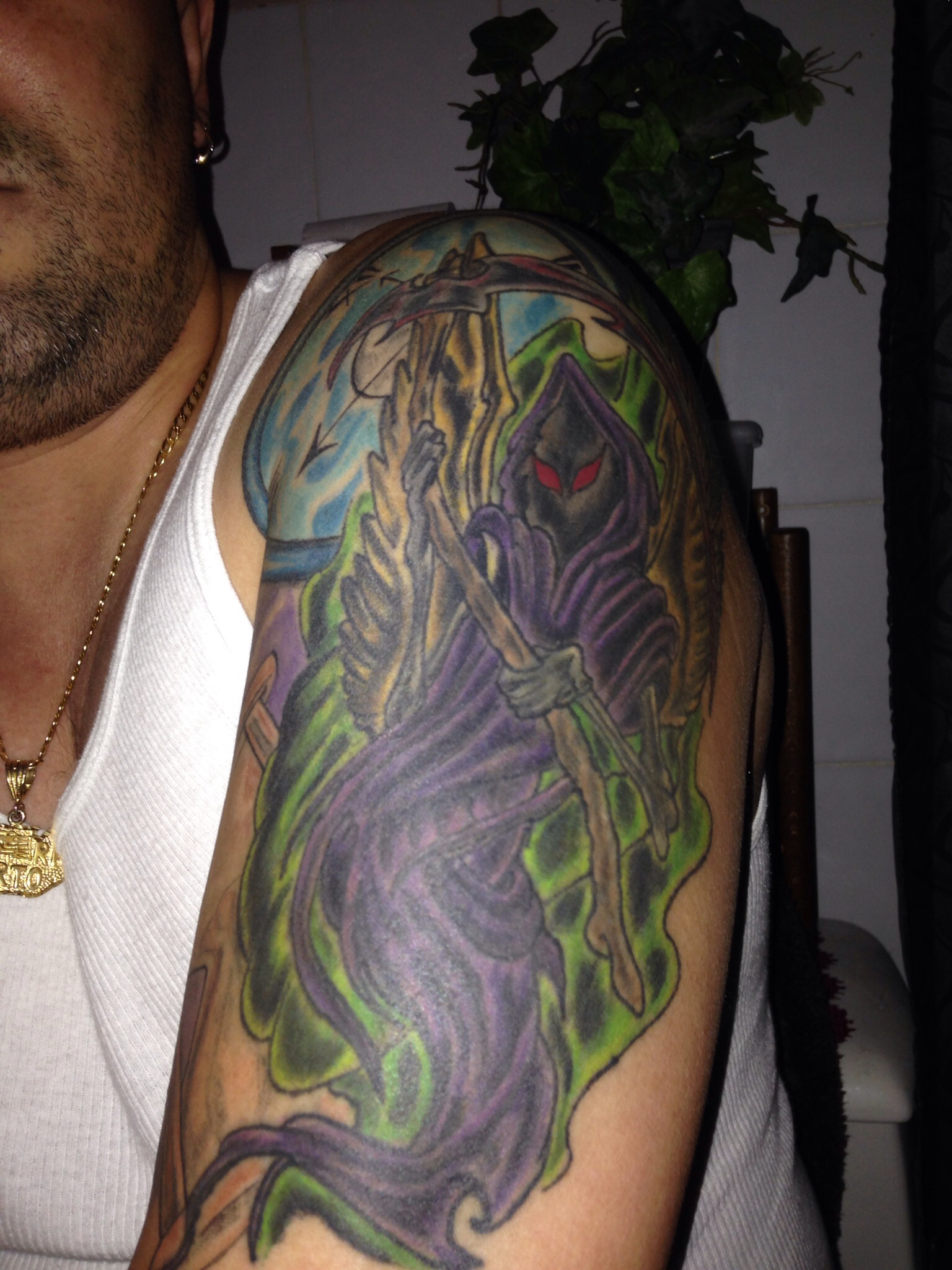 Colored Death Grim Reaper Tattoo On Left Half Sleeve