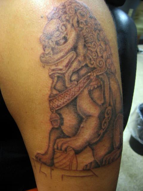Grey Ink Asian Foo Dog Tattoo On Bicep