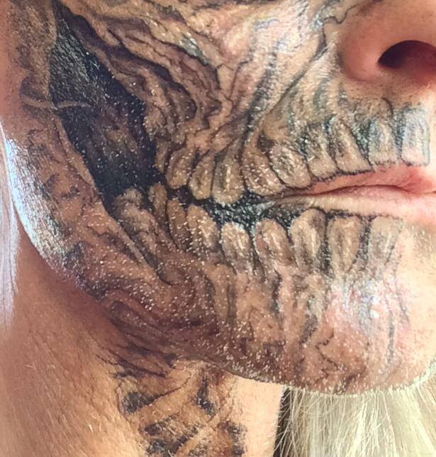 Heinrich Scary Face Tattoo