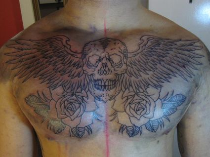 8419c68994097 Grey Rose Flowers And Angel Winged Skull Chest Tattoo