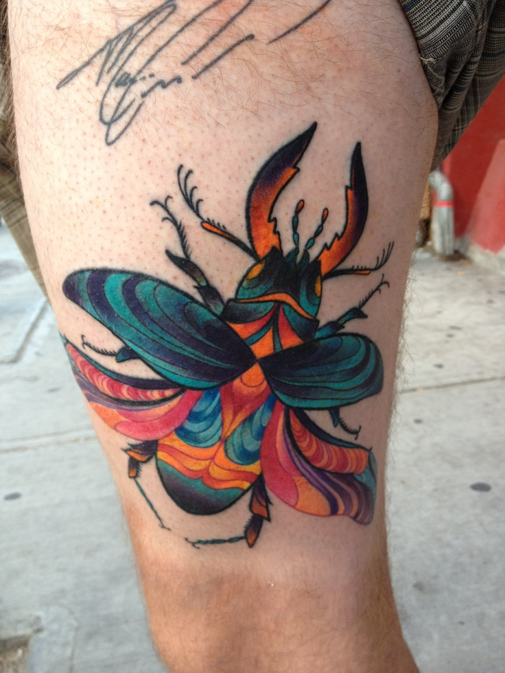 Colored beetle tattoo on thigh for Colorful thigh tattoos