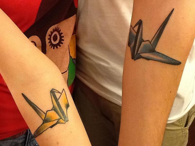 Paper crane tattoos on both arms for Paper crane tattoo