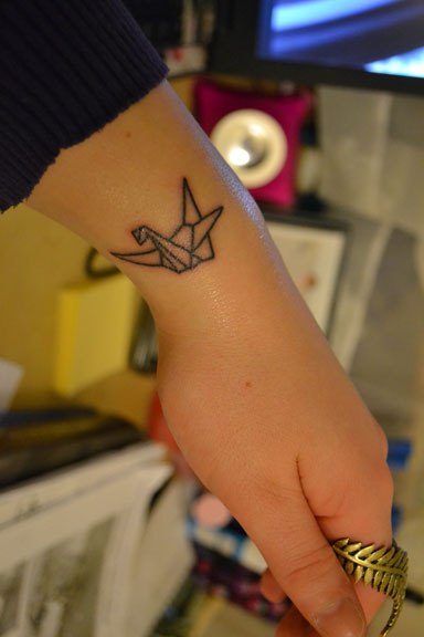 Small Paper Crane Tattoo On Arm