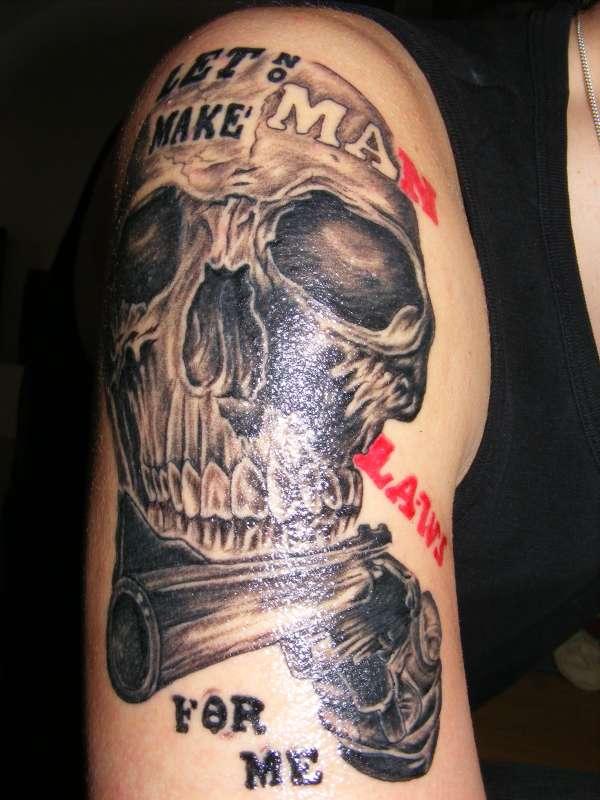 Skull and Gun Tattoo On Right Half Sleeve