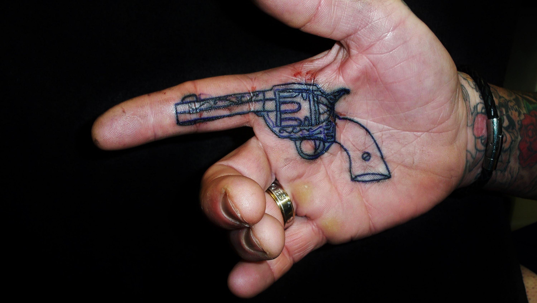 Small Gun Tattoo Inside Hand