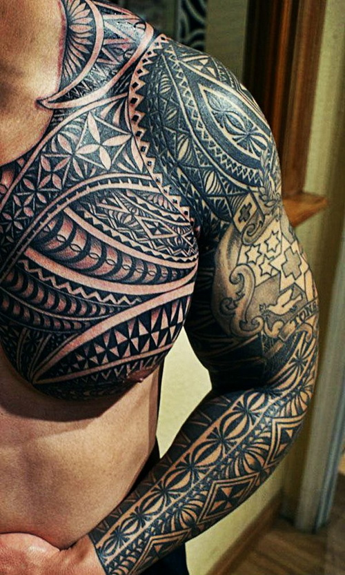 Awesome black ink maori tribal tattoo on chest and left sleeve for Black tribal tattoo ink