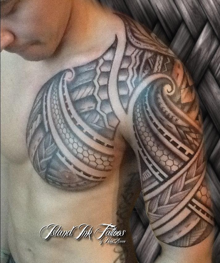 Awesome Polynesian Chest And Half Sleeve Tattoo