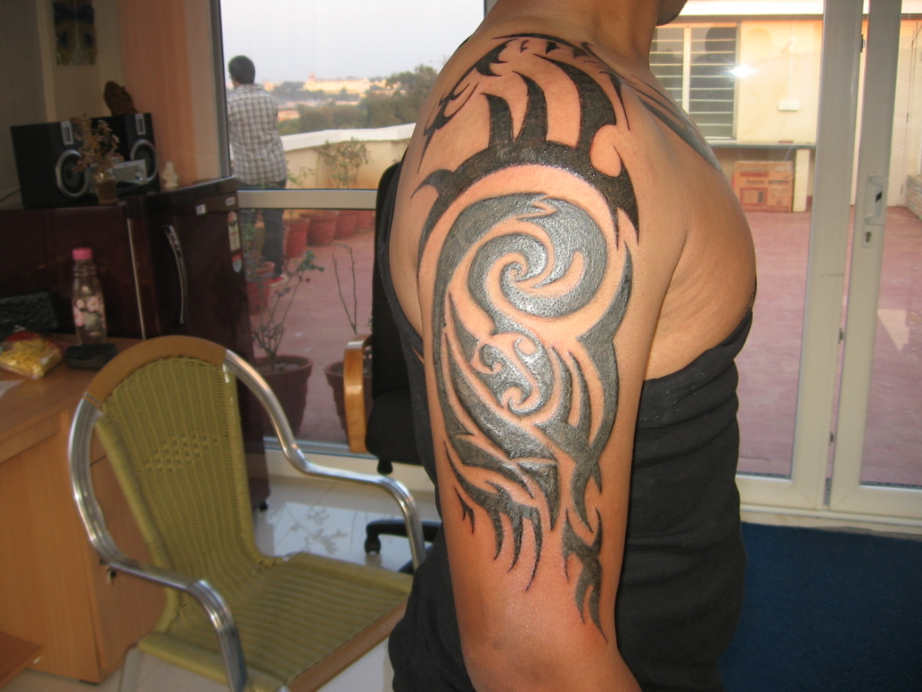 Awful Black Ink Tribal Half Sleeve Tattoo For Men