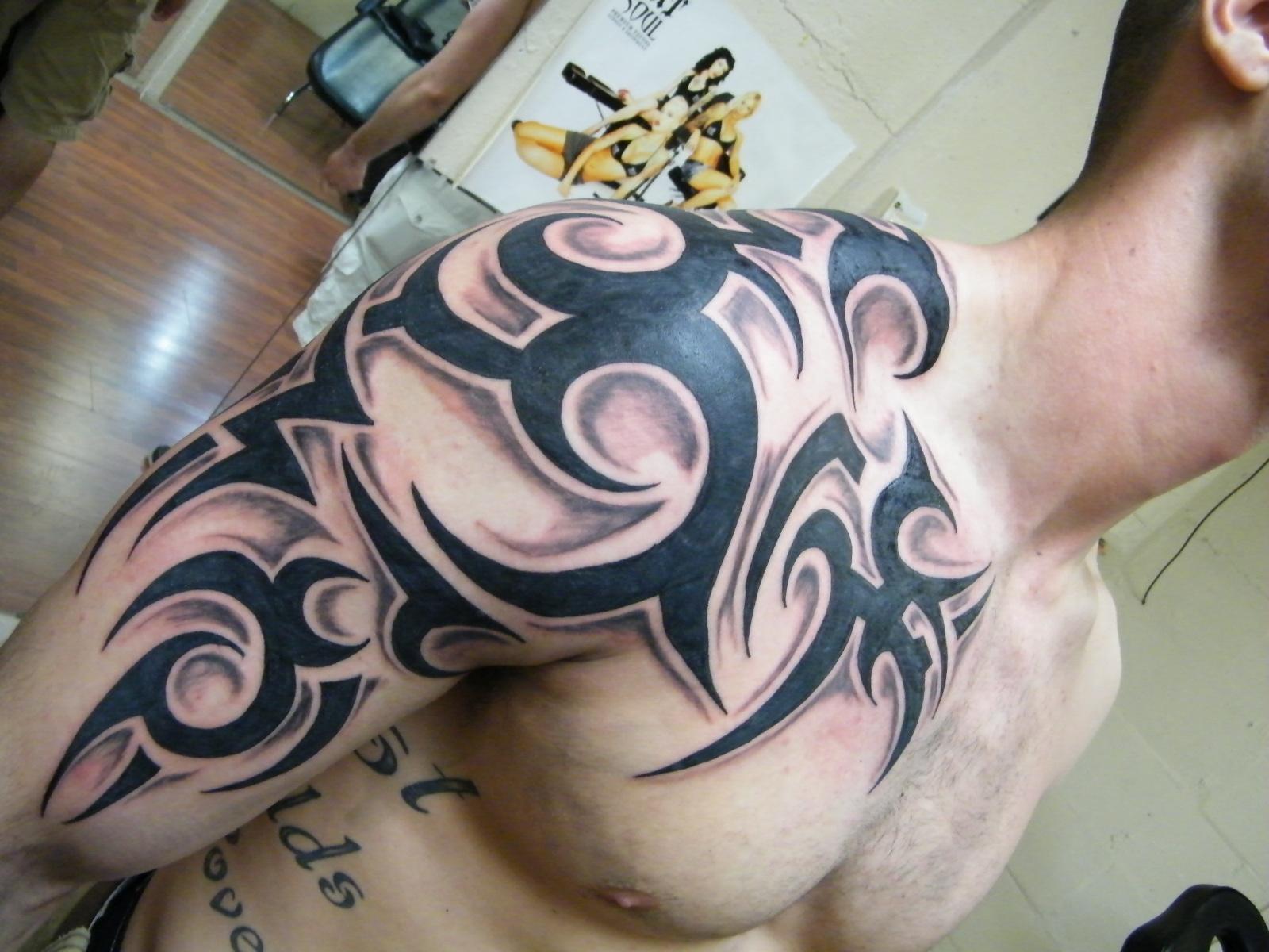 Beautiful Black Ink Tribal Half Sleeve Tattoo For Men