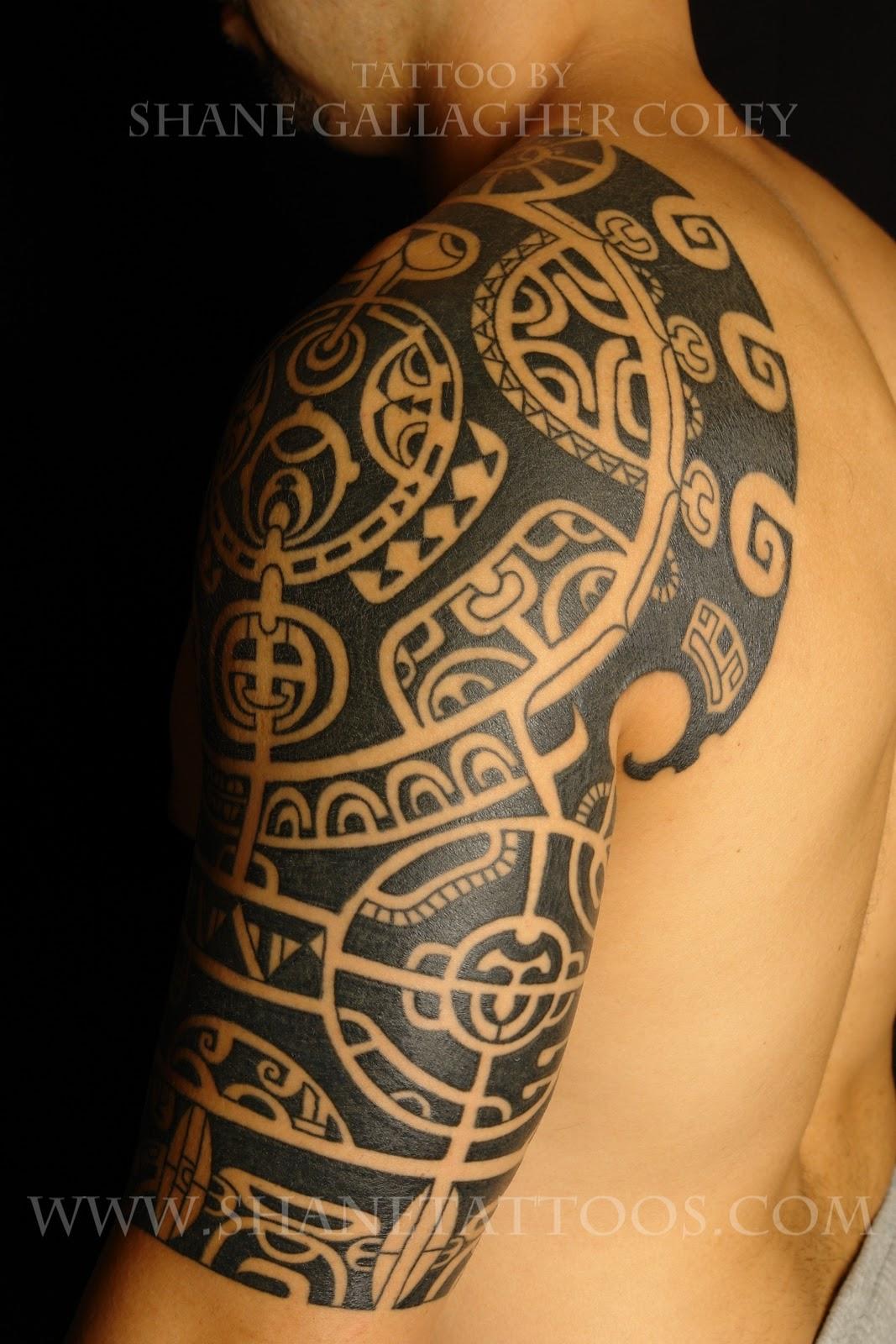 b8ed36213 Black Ink Maori Tattoo On Man Left Sleeve