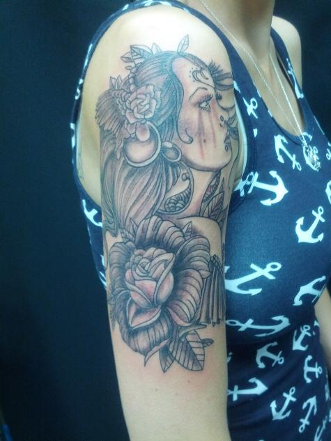 grey rose flower and girl head half sleeve tattoo