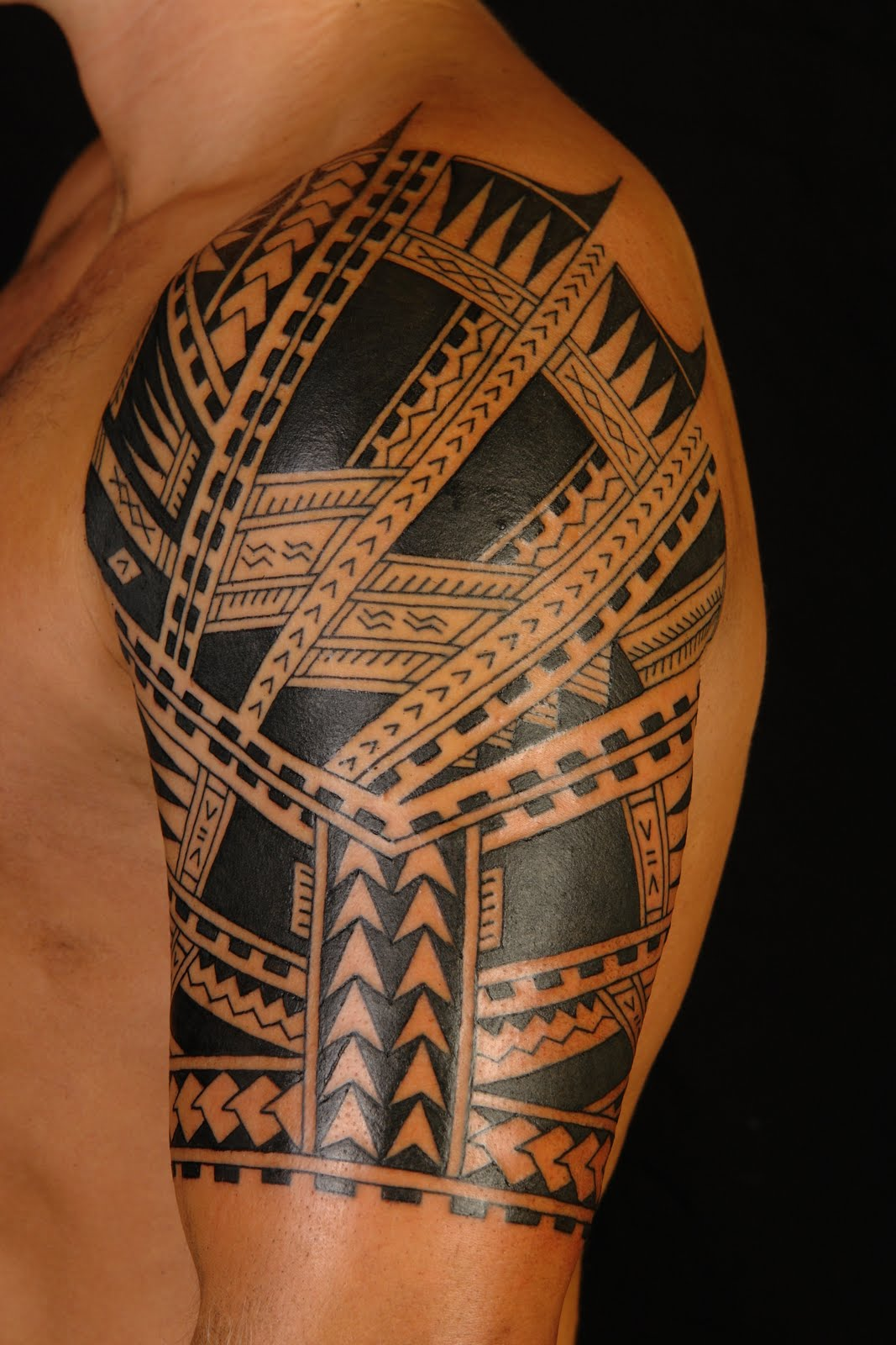 Polynesian Half Sleeve Tattoo On Left Shoulder
