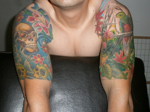 Skull And Flowers Half Sleeve Tattoo