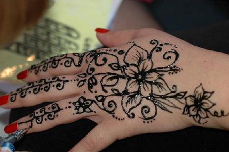 Black Ink Henna Flowers Hand Tattoo