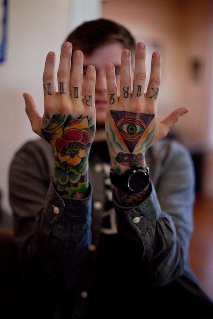 Colored flower and illuminati eye tattoo on both hands for Eye finger tattoo