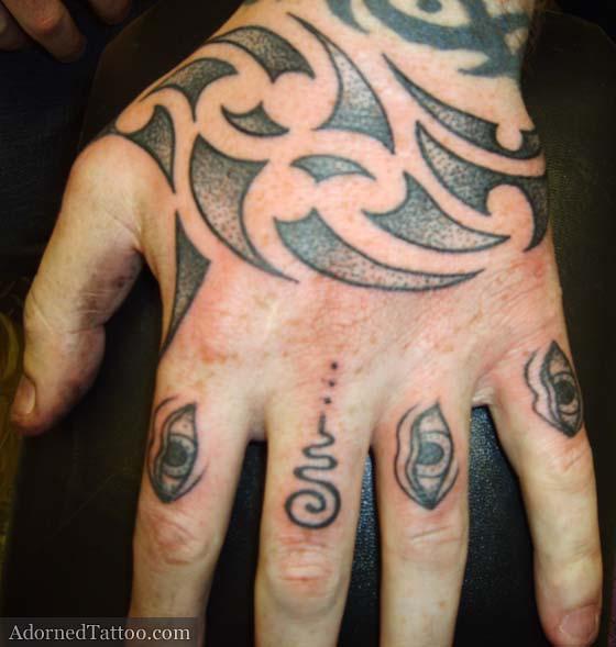 Grey Ink Maori Tribal Tattoo On Left Hand
