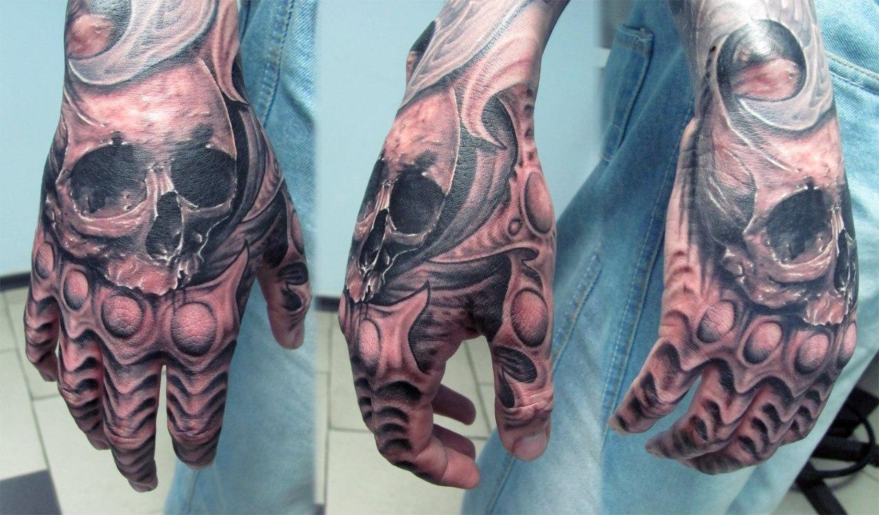 Grey ink skull hand tattoos