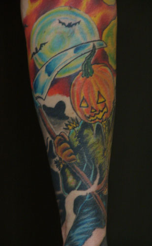 Pumpkin With Reaper Tattoo On Sleeve