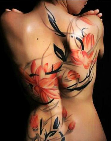 Awesome Colored Flowers Hawaiian Tattoo On Girl Back