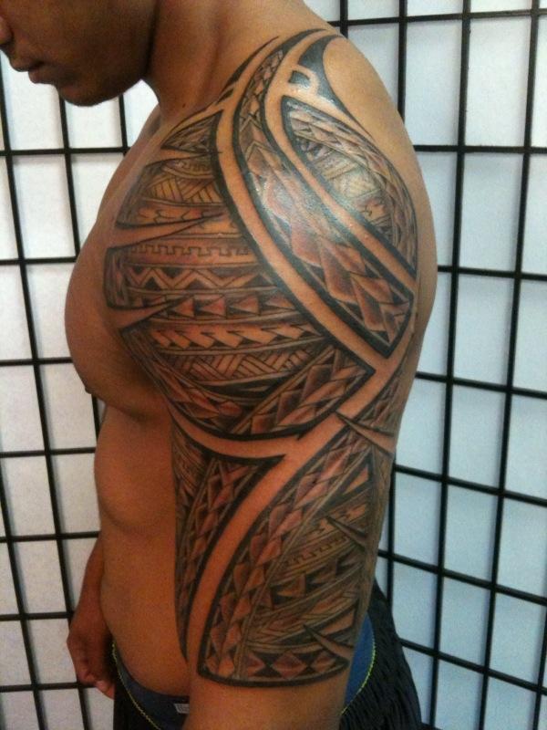 Beautiful hawaiian tattoo on left half sleeve for Beautiful half sleeve tattoos
