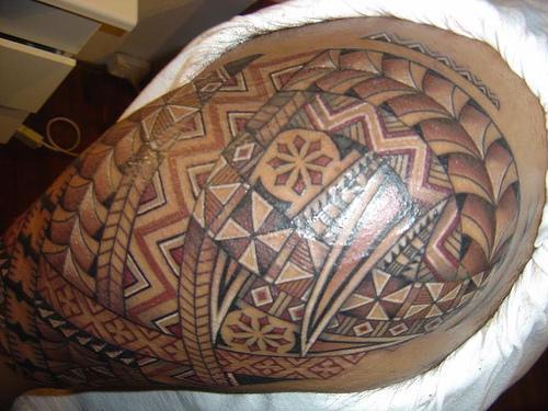Grey Ink Tribal Hawaiian Tattoo On Half Sleeve