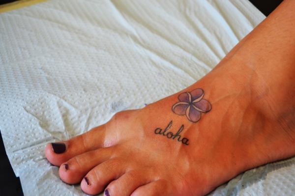 578439621 Hawaiian Flower Tattoo On Left Foot