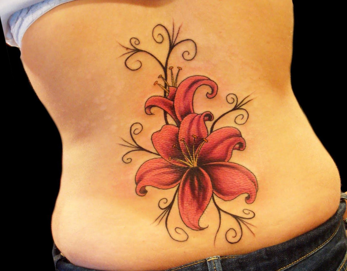 Hawaiian flower tattoo on right lowerback hawaiian flower tattoo on lowerback izmirmasajfo