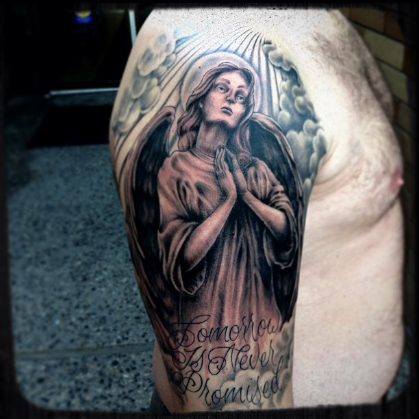 Praying angel tattoo images designs for Angel half sleeve tattoo