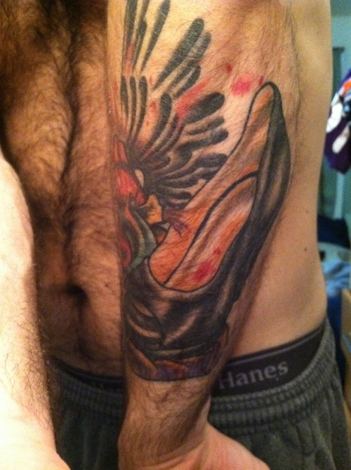 Man Left Sleeve Heel Tattoo