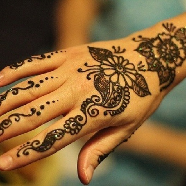 Girl With Henna Tattoo On Back Hand