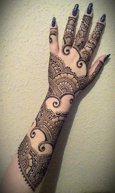 Grey Ink Henna Tattoo On Girl Left Sleeve