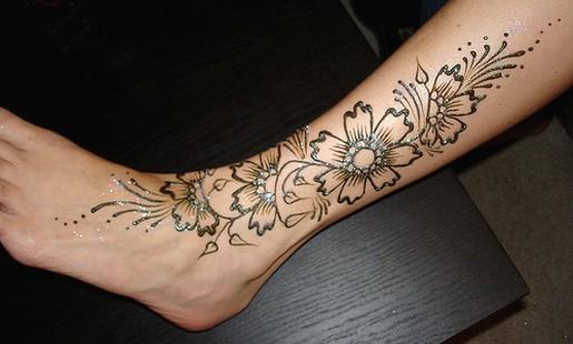 Mehndi Tattoo Half Sleeve : Skull and flowers henna tattoo on left half sleeve