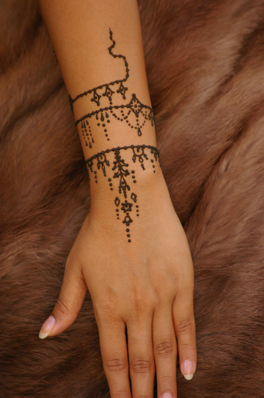 mind blowing henna on left