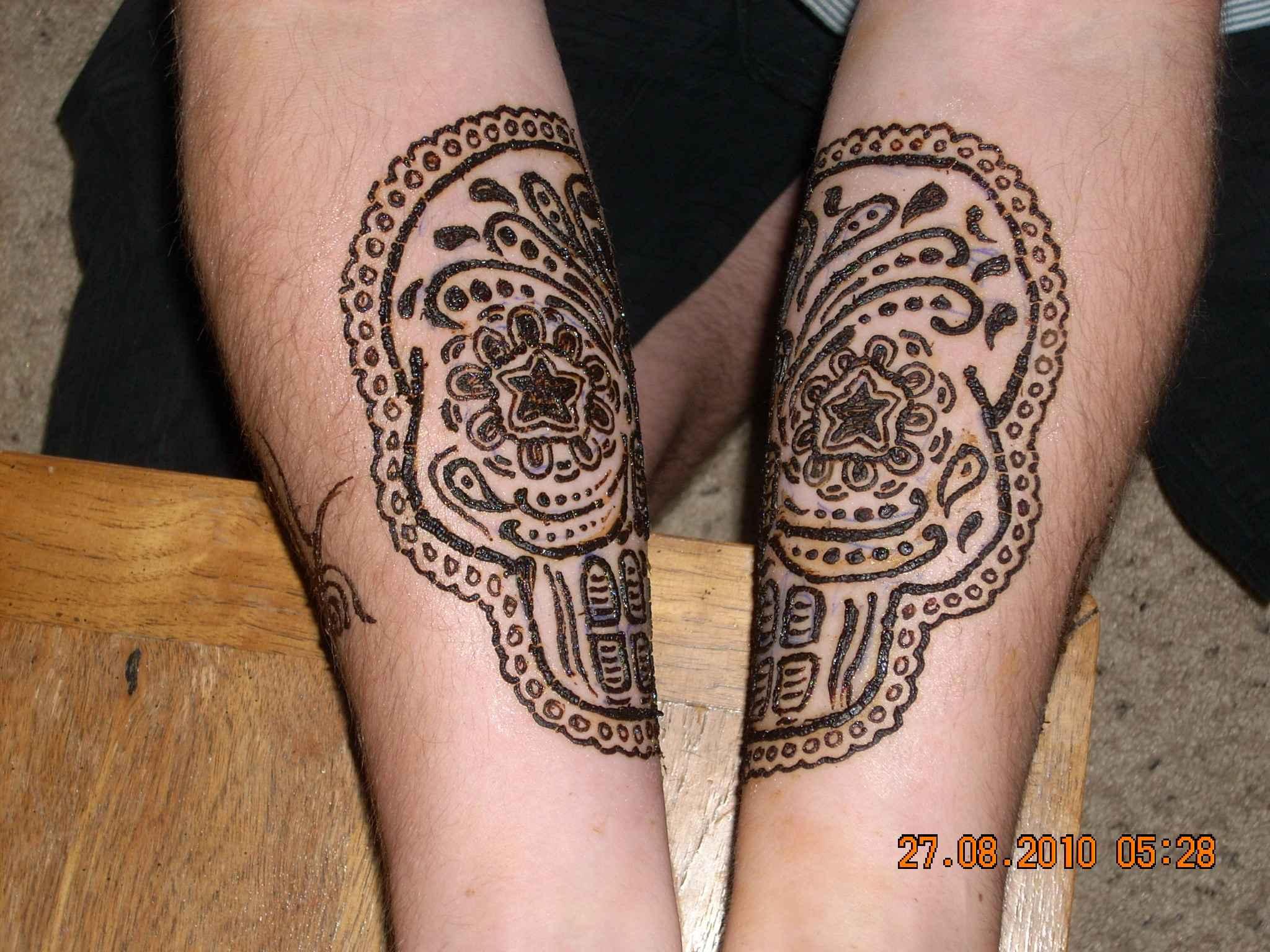 Mehndi Wolf Tattoo : Tribal henna tattoo on left forearm