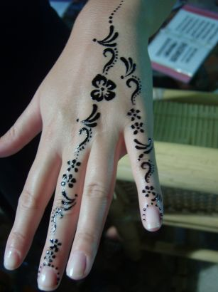 Cute Henna Tattoo On Girl Left Hand