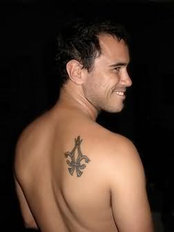 Fleur de lis tattoo symbol tattoo on arm for Simple back tattoos for guys