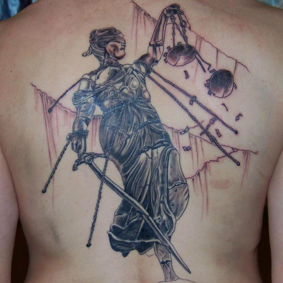 Attractive Grey Ink Justice Tattoo On Side Rib