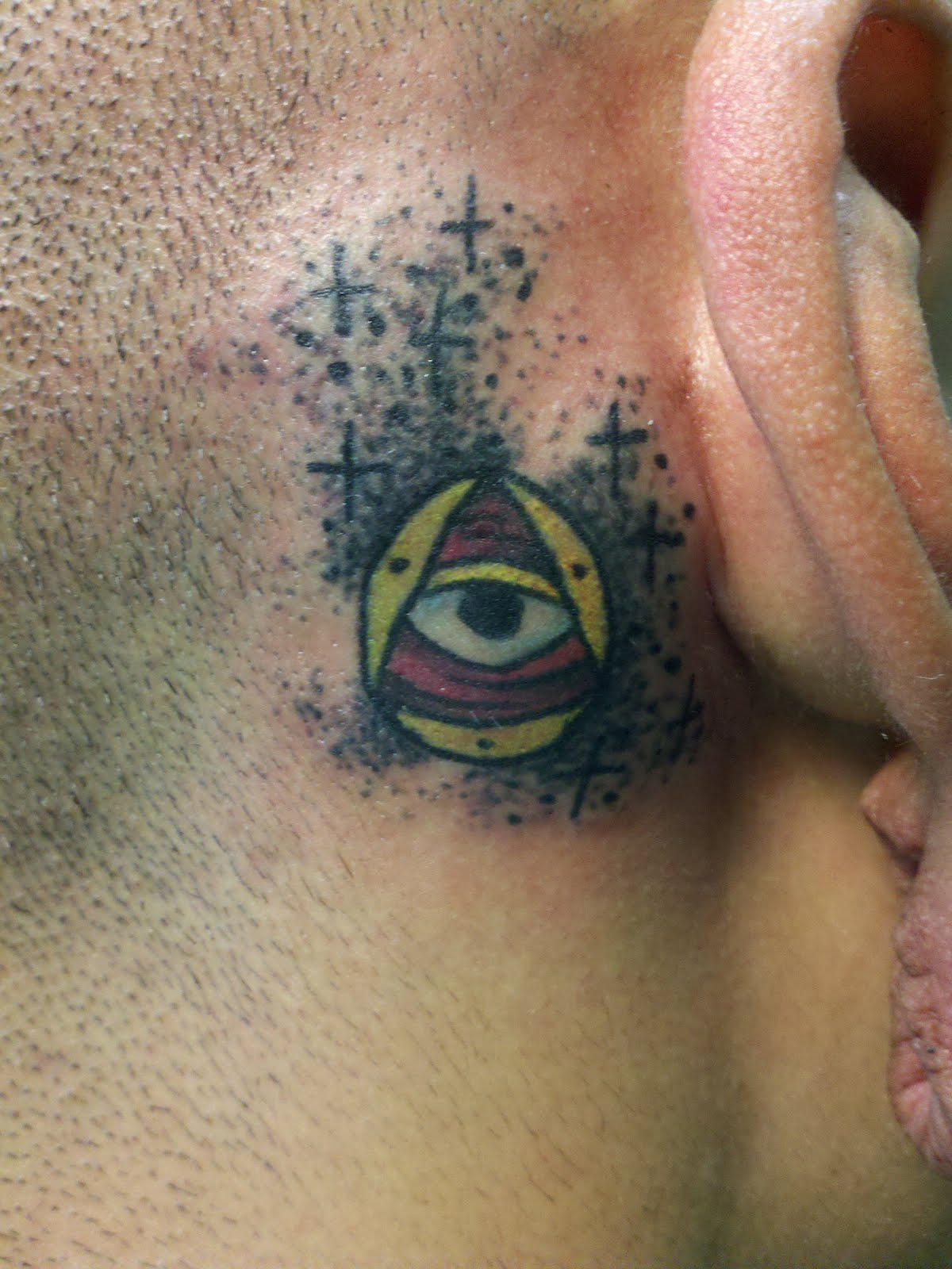 Color illuminati eye tattoo behind ear izmirmasajfo