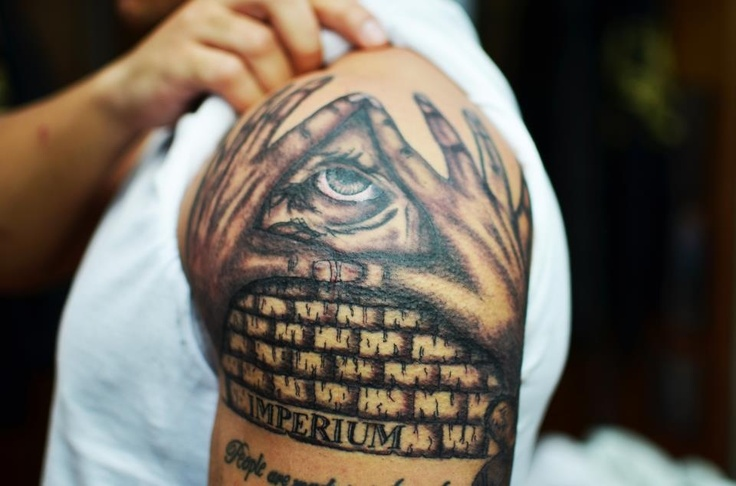 Grey Ink Illuminati Eye Tattoo On Man Left ShoulderIlluminati Tattoo Sleeve
