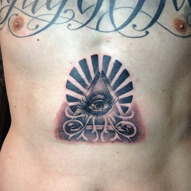 Grey Ink Illuminati Eye Tattoo On Stomach